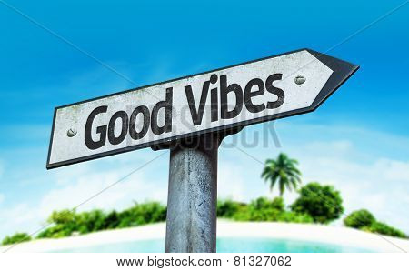 Good Vibes sign with a beach background