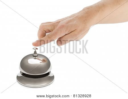 Hand of a man using hotel bell with reflection isolated on white background.