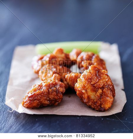 boneless barbecue chicken wings on slate table