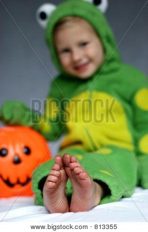 Girl in frog costume