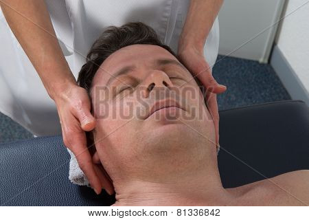 A Man Having A Chinese Massage On Table Massage