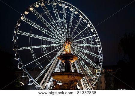 Ferris Wheel And Monument