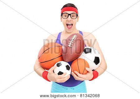 Nerdy guy holding a bunch of sports balls isolated on white background