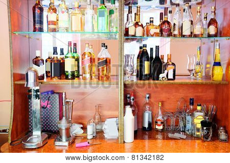 Assorted colorful bottles of alcoholic drinks in a bar