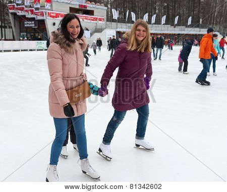 Girls Skating And Smiling At Park