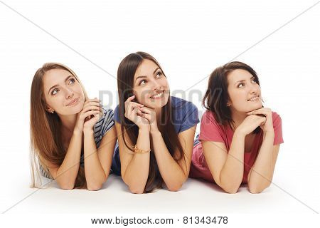 Girls friends lying smiling on floor