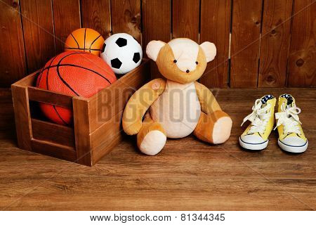 Bear toy with toys on wooden background