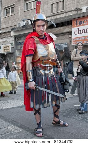 Jerusalem, Israel - March 15, 2006: Purim Carnival.  A Young Man Dressed In A Suit Of A Roman Soldie