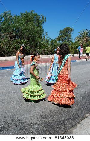 Spanish girls in flamenco dresses.