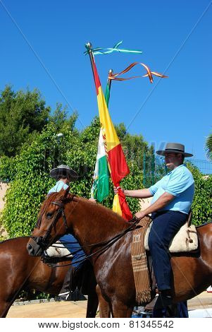 Flag bearers on horses, Marbella.