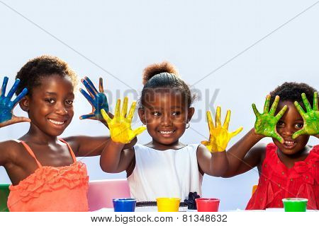African Threesome Showing Painted Hands.
