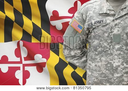 American Soldier With Us State Flag On Background - Maryland