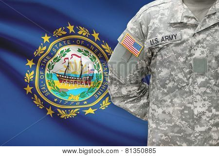 American Soldier With Us State Flag On Background - New Hampshire