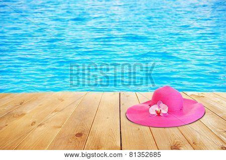 Summer hat on sea background