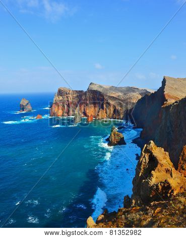 Colorful pinnacles lit sunset. Atlantic storms. Arid eastern tip of the island of Madeira