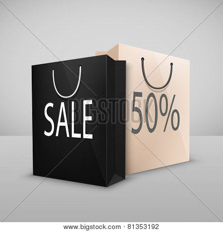 two shopping bags with written sale
