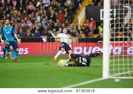 VALENCIA, SPAIN - JANUARY 25: Beto saves the ball after Jose Gaya shot during Spanish League match between Valencia CF and Sevilla FC at Mestalla Stadium on January 25, 2015 in Valencia, Spain