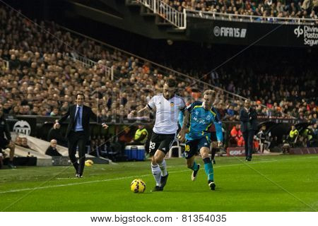 VALENCIA, SPAIN - JANUARY 25: Otamendi with ball during Spanish League match between Valencia CF and Sevilla FC at Mestalla Stadium on January 25, 2015 in Valencia, Spain