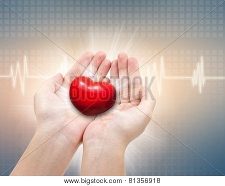 Medical And The Cares Concept, Red Heart In Female Hand With Ecg Background