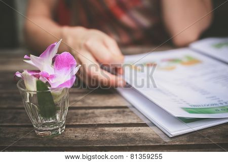 Woman Studying Menu