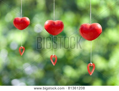 Red Heart Mobile Hanging On Green Bokeh  Background
