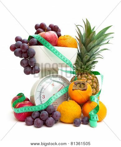 Ripe Fresh Fruit, Kitchen Scale And Measuring Tape Isolated On A White Background