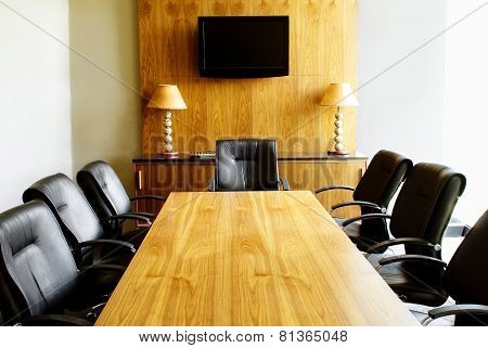 Modern Boardroom with Wooden Table, Black Leather Chairs and African Decor
