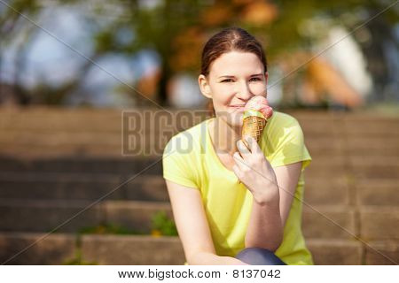 Woman Eating Ice Cream In Summer