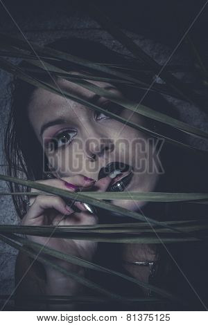 Brunette, Sensual young girl hidden behind the branches of a tree