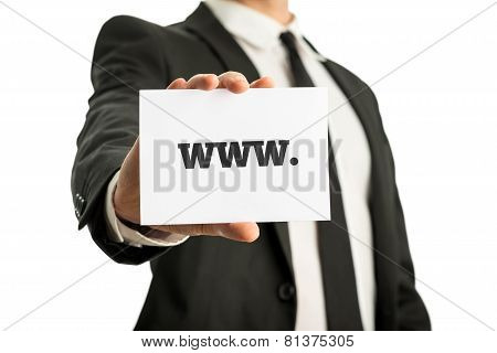Businessman In A Suit Holding Up A Business Card With Www Sign