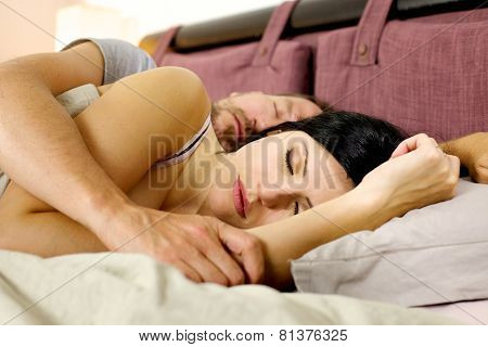 Couple Sleeping Peacefully In Bed During Vacation In Hotel