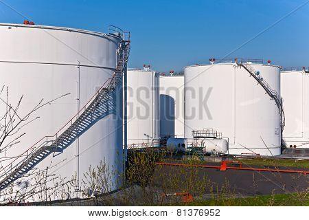 White Tanks In Tank Farm With Blue Sky
