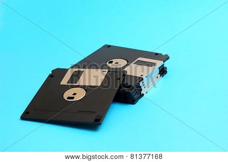 disk floppy magnetic computer data storage support on a blue bac