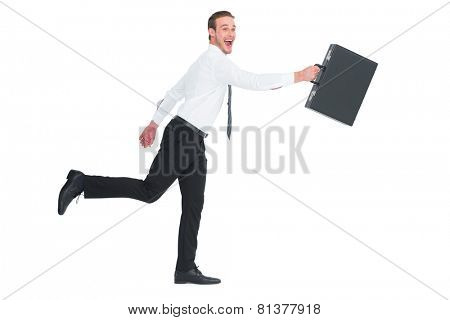 Happy businessman leaping with his briefcase on white background