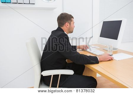 Businessman at desk in his office