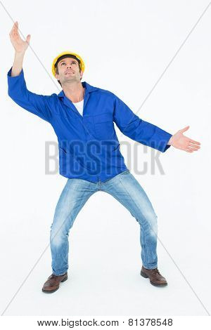 Handsome male architect trying to catch over white background