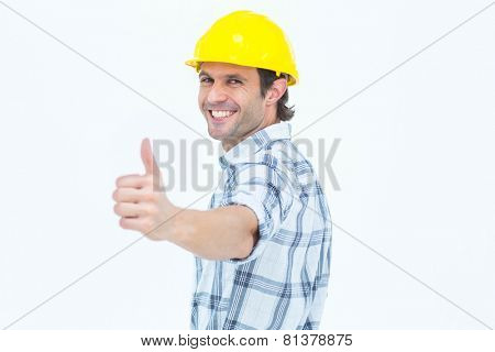 Portrait of happy technician gesturing thumbs up over white background