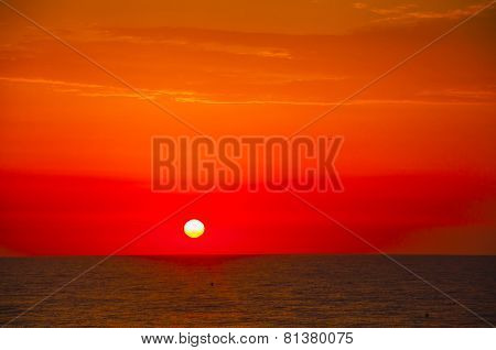 Spanish Morning Sun On Red Sky With Yellow Clouds By The Mediterranean Sea