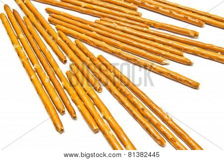 Many Salted Breadsticks On White