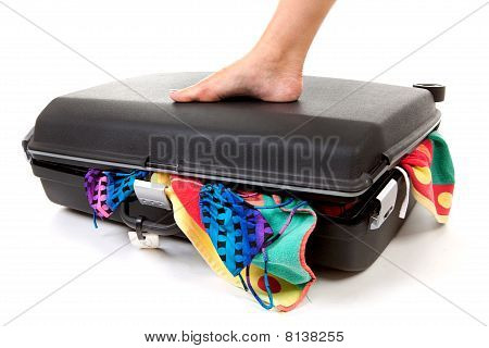 Foot On Stuffed Suitcase