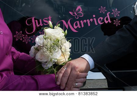 wedding rings and a bouquet of roses