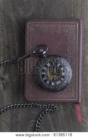 Pocket Watch On Old Book