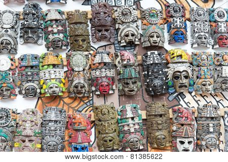 Mayan wooden handcrafted masks on the street market in Cacun, Mexico.