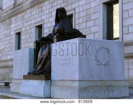 seated statue outside the boston public library