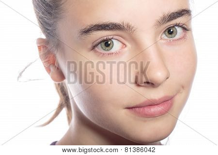 Close Up Portrait Of A Smiling Teenage Girl, Isolated On White