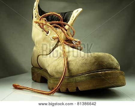 Military Boot. Old Heavy And Destroyed.