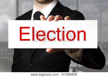 Businessman Holding Sign Election