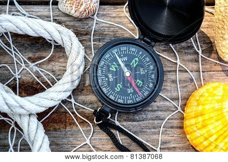 Wooden Background With Starfish, Compass And Shell - Maritime Decoration.