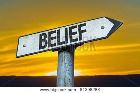 Belief sign with a sunset background