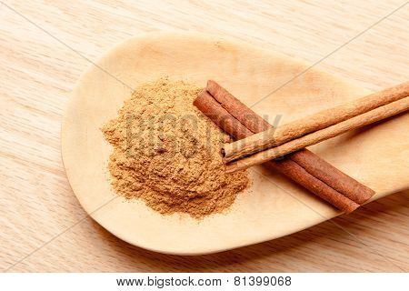 Cinnamon Sticks And Cinnamon Powder On A Wooden Spoon